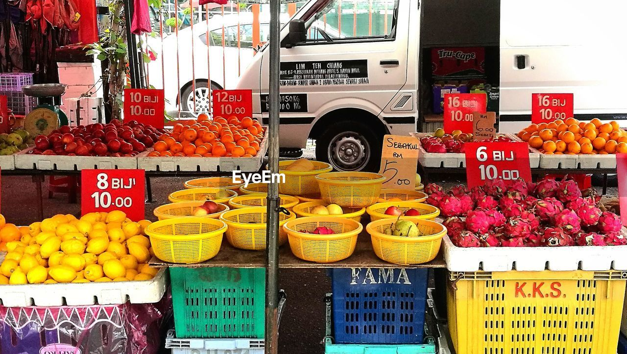 fruit, market stall, for sale, price tag, market, food, freshness, food and drink, retail, banana, text, healthy eating, variation, choice, vegetable, outdoors, abundance, communication, day, small business, tomato, no people, large group of objects, multi colored