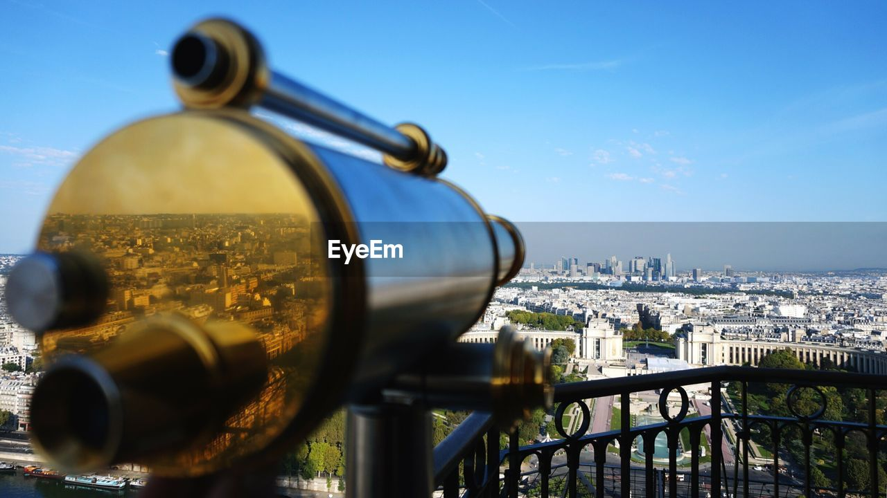 Close-Up Of Coin Operated Binoculars Facing Cityscape