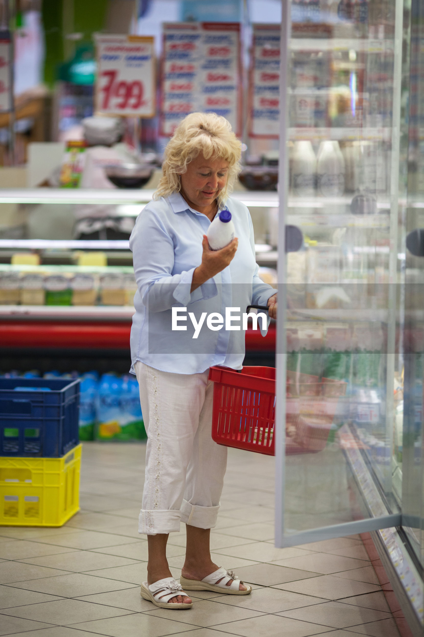 Woman buying groceries in supermarket