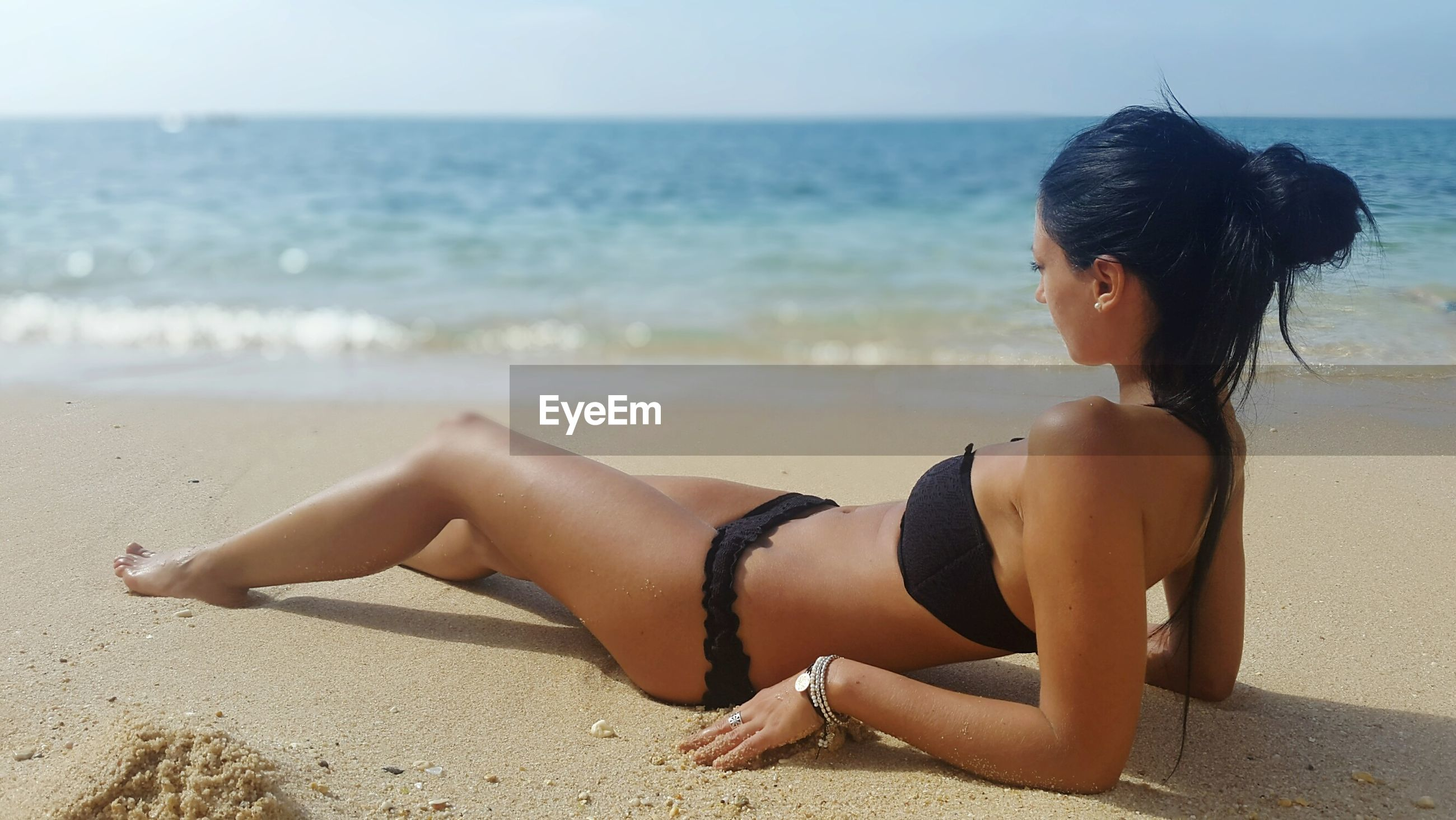 beach, sea, horizon over water, shore, sand, water, lifestyles, leisure activity, vacations, young women, relaxation, young adult, person, full length, sitting, summer, sky