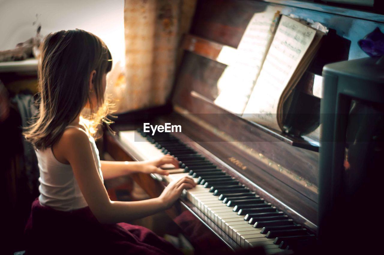 Girl Playing Piano At Home