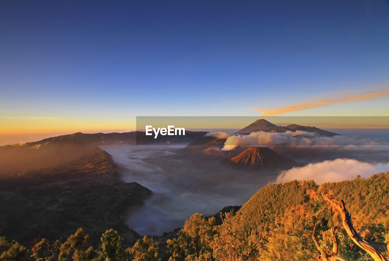 View Of Volcanic Landscape Against Sky During Sunset