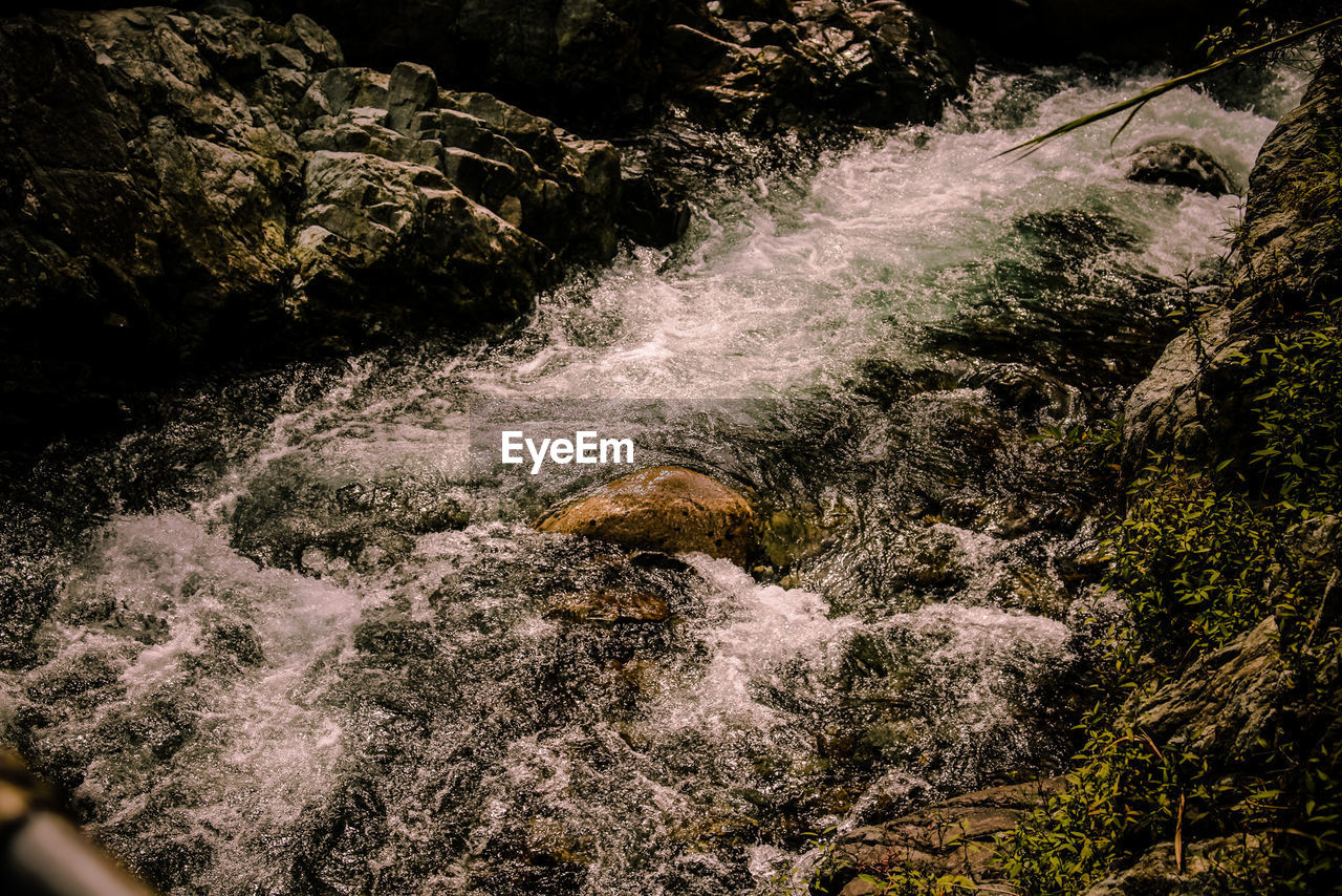 motion, waterfall, flowing water, nature, water, beauty in nature, no people, river, rock - object, outdoors, long exposure, scenics, high angle view, day, waterfront, rapid, forest, power in nature