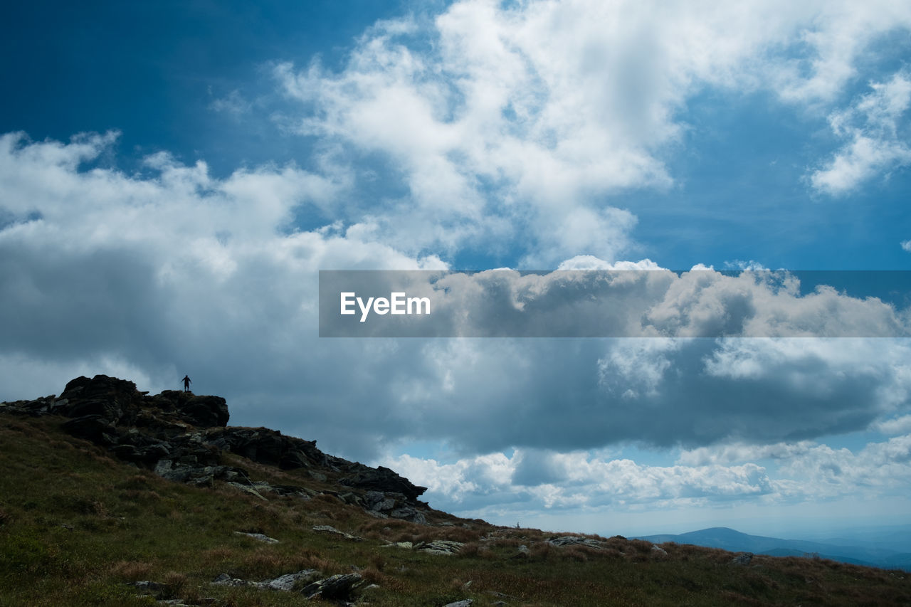 cloud - sky, sky, beauty in nature, scenics - nature, tranquil scene, tranquility, nature, environment, day, rock, mountain, non-urban scene, landscape, land, no people, outdoors, low angle view, rock - object, idyllic