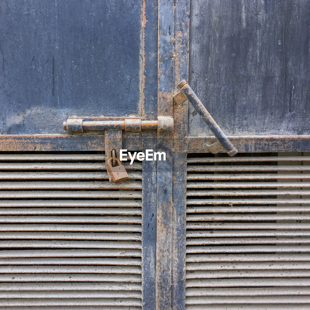 metal, no people, safety, architecture, security, day, pattern, wall - building feature, protection, outdoors, old, entrance, close-up, rusty, closed, wood - material, gray, building exterior, latch, door, iron, alloy, corrugated, steel