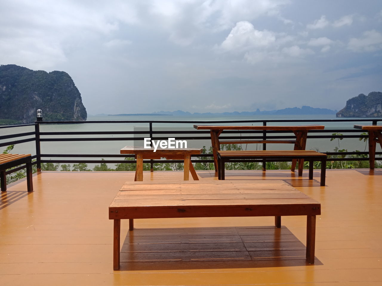 cloud - sky, seat, table, sky, mountain, wood - material, scenics - nature, chair, no people, railing, absence, beauty in nature, empty, nature, tranquil scene, day, water, tranquility, wood, outdoors, setting