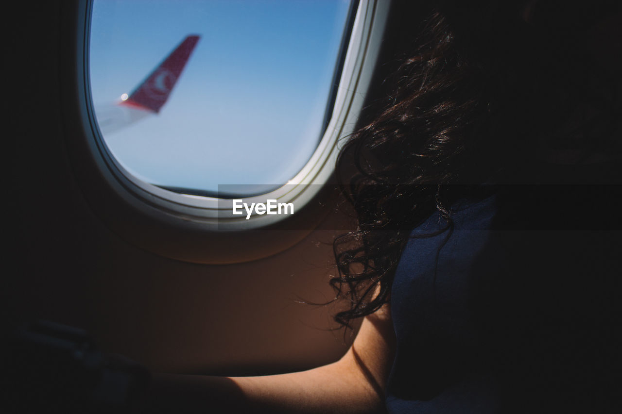 window, mode of transport, transportation, real people, one person, day, close-up, indoors, airplane, sky