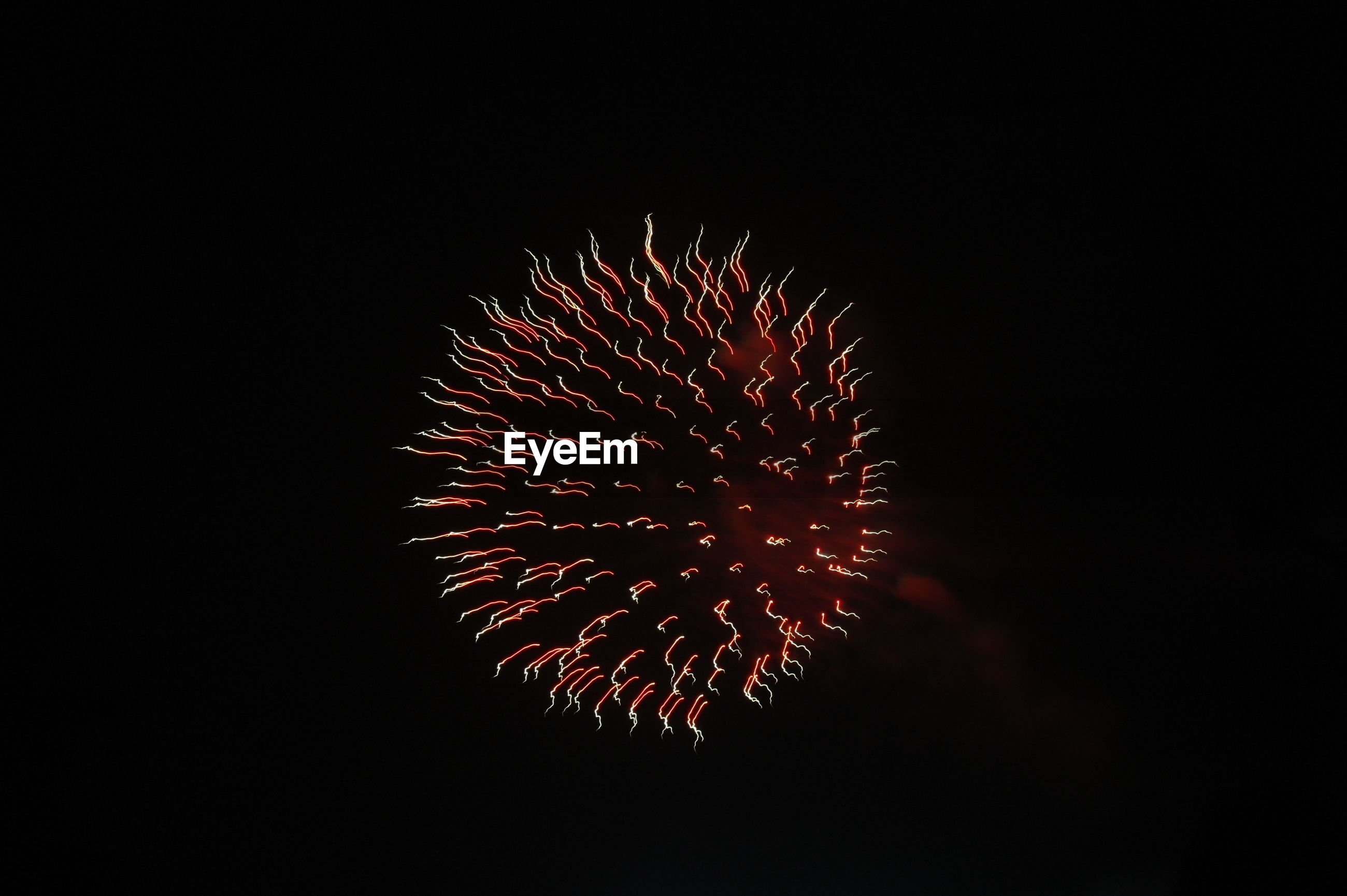 LOW ANGLE VIEW OF FIREWORKS IN NIGHT SKY