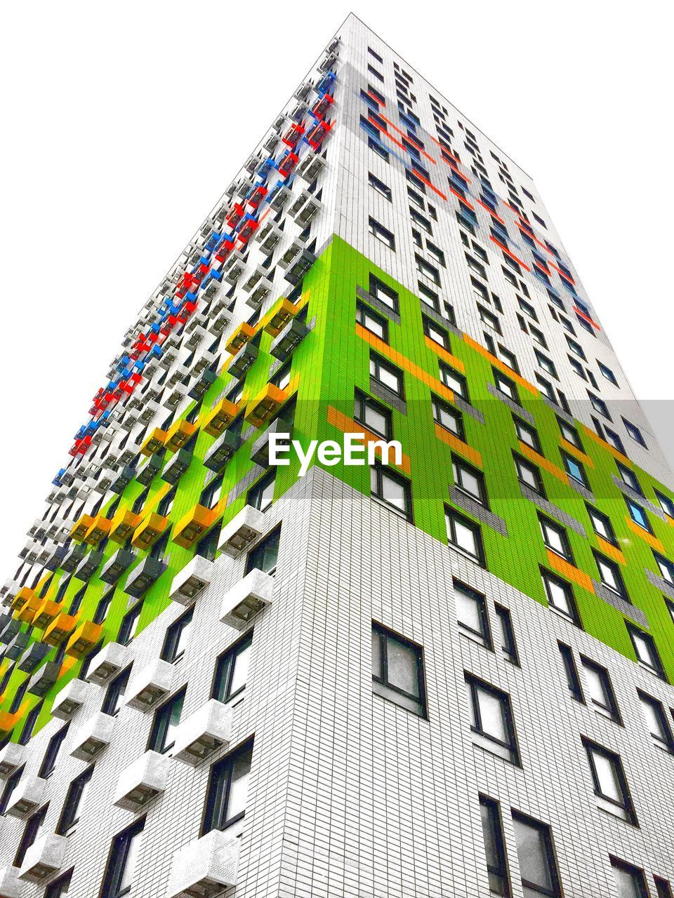 building exterior, built structure, architecture, low angle view, building, city, modern, sky, clear sky, no people, office building exterior, nature, window, tall - high, day, office, outdoors, multi colored, tower, residential district, skyscraper, apartment