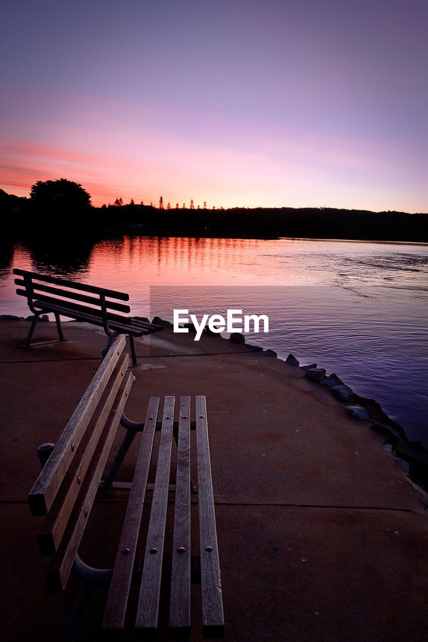 water, sunset, sky, tranquility, tranquil scene, beauty in nature, scenics - nature, lake, reflection, wood - material, nature, orange color, idyllic, no people, non-urban scene, pier, tree, outdoors, silhouette