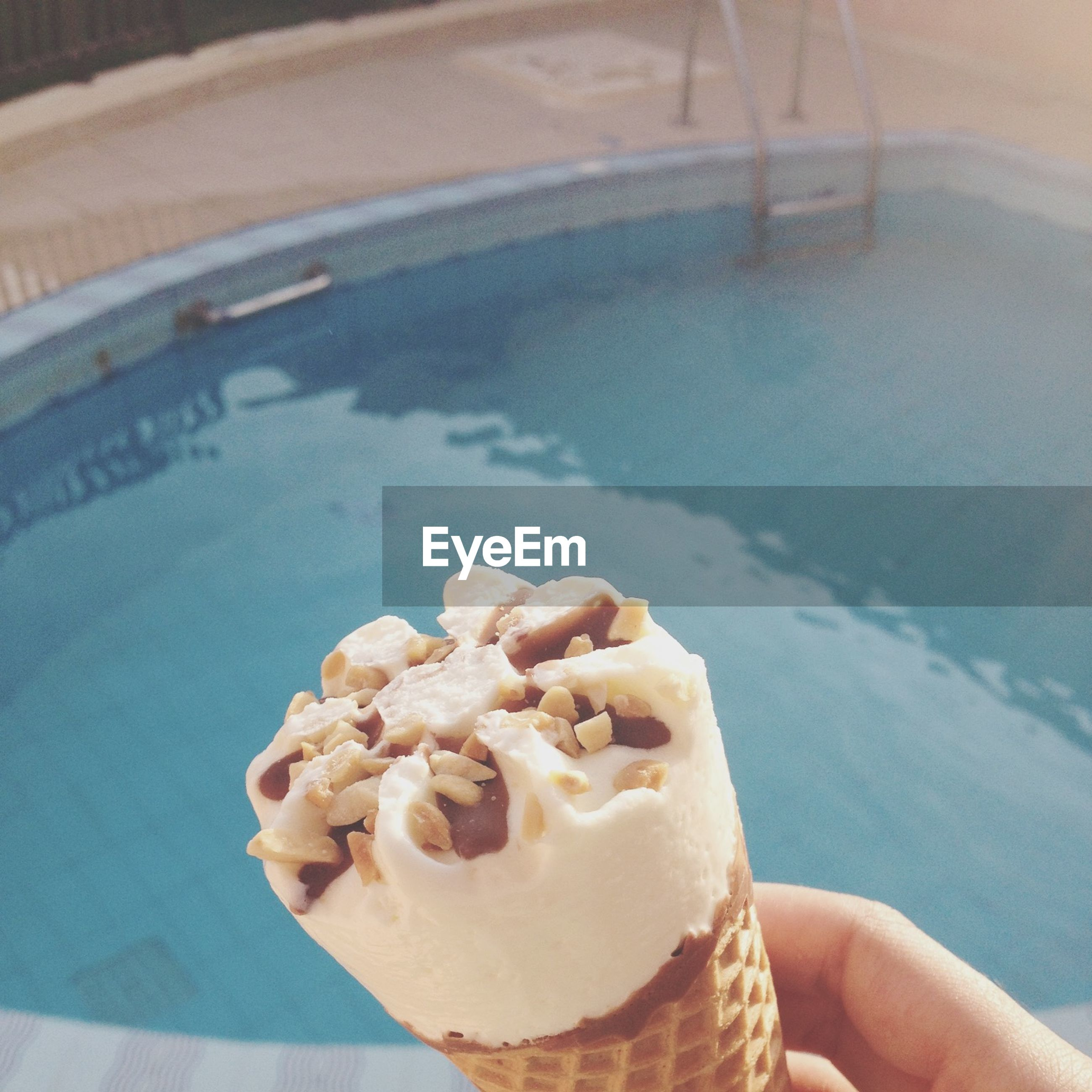 person, food, freshness, cropped, holding, part of, sweet food, ice cream, personal perspective, indulgence, ready-to-eat, close-up, unrecognizable person, frozen food, focus on foreground, lifestyles, temptation, day, outdoors
