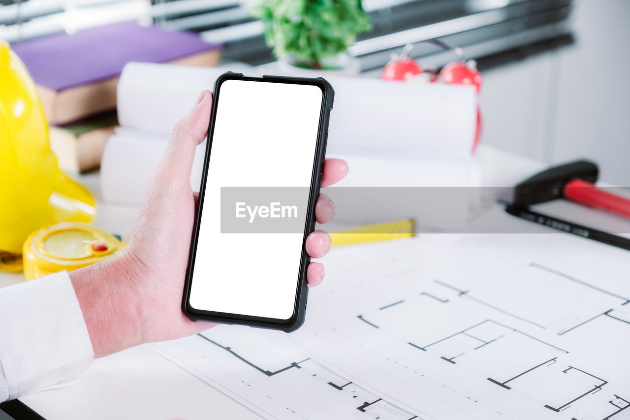 human hand, wireless technology, communication, hand, mobile phone, portable information device, smart phone, technology, holding, one person, human body part, connection, screen, table, real people, close-up, device screen, telephone, touch screen, finger