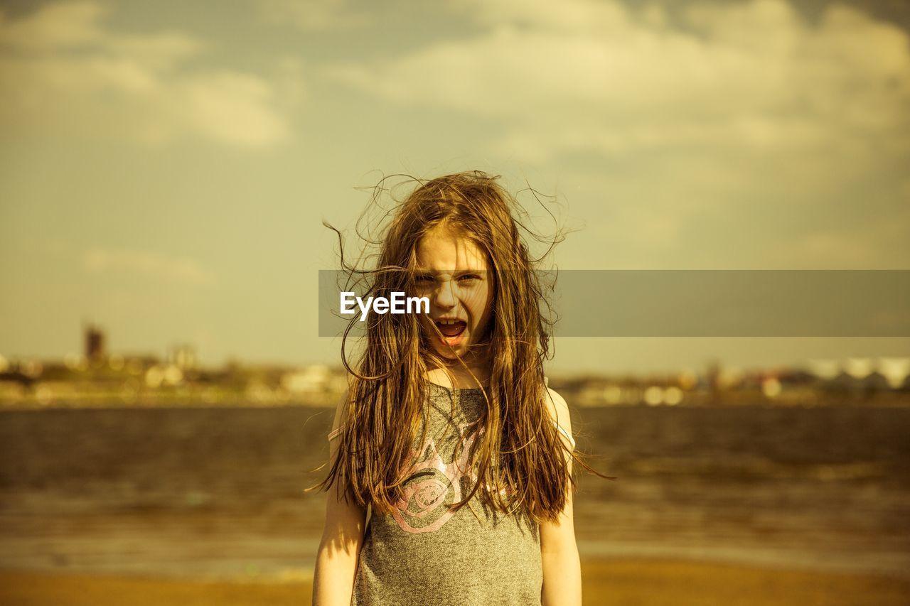 Portrait Of Cheerful Girl Screaming