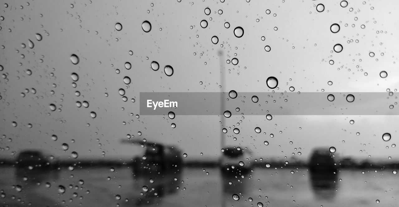 drop, wet, rain, water, glass - material, window, transparent, no people, full frame, focus on foreground, close-up, nature, backgrounds, raindrop, rainy season, indoors, sky, day, glass