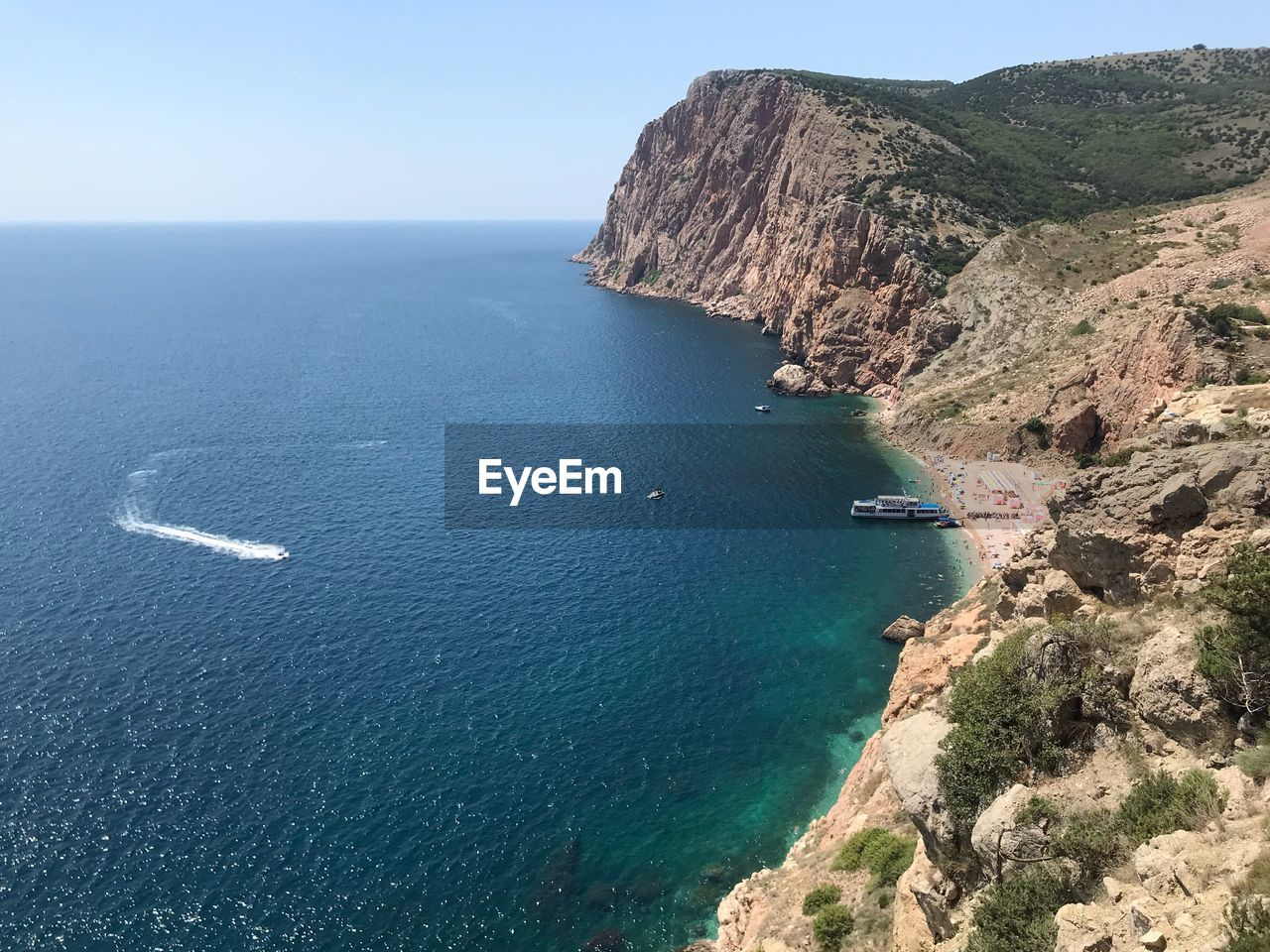 sea, scenics - nature, water, beauty in nature, tranquil scene, tranquility, nature, day, mountain, land, blue, nautical vessel, no people, sky, high angle view, transportation, idyllic, mode of transportation, cliff, horizon over water, mountain range, outdoors, formation