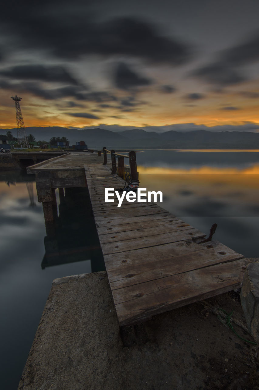 water, sky, cloud - sky, sunset, sea, scenics - nature, nature, beauty in nature, pier, tranquility, tranquil scene, wood - material, no people, architecture, jetty, the way forward, built structure, orange color, outdoors, long