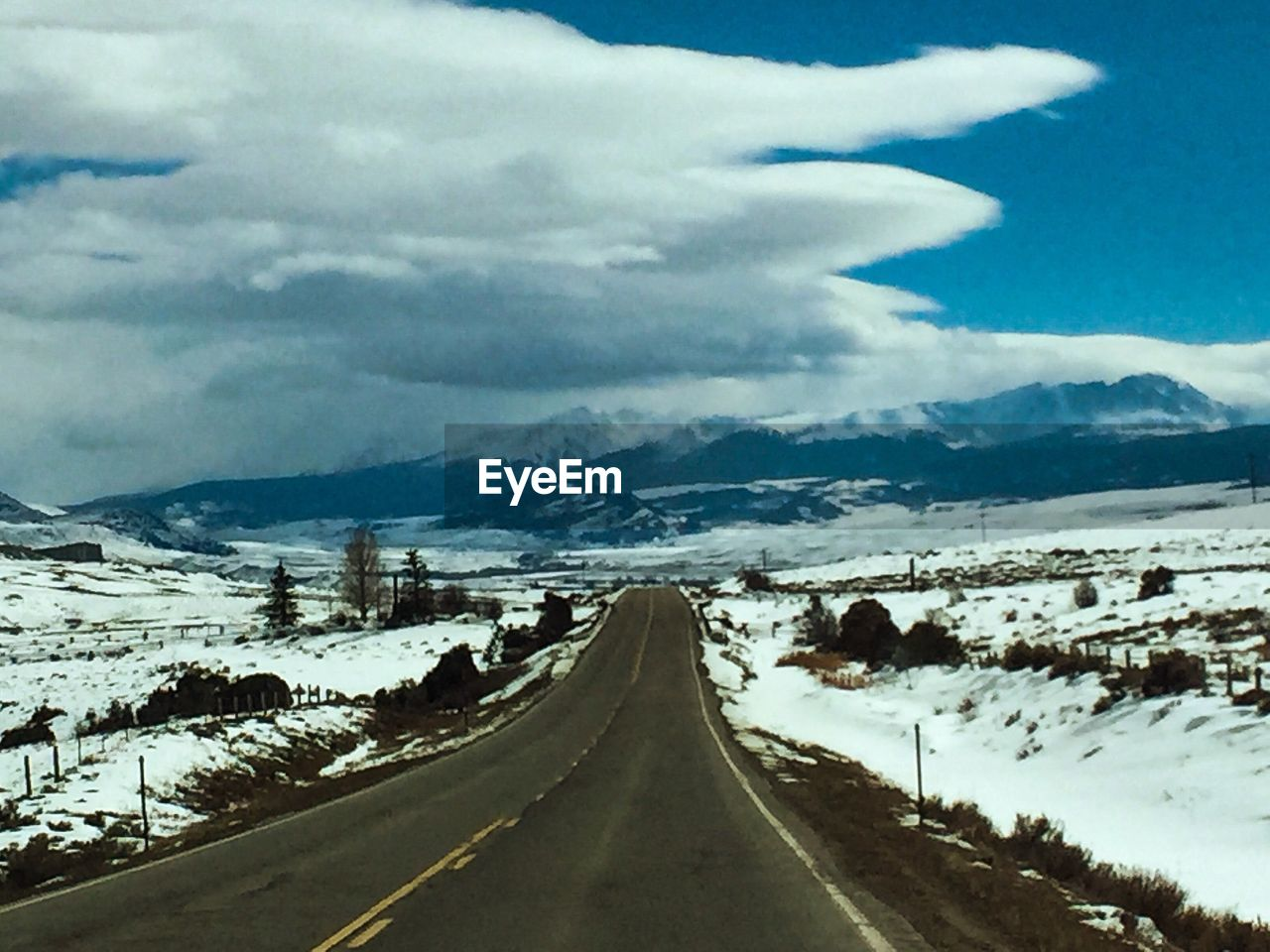 sky, transportation, cloud - sky, road, direction, the way forward, scenics - nature, diminishing perspective, mountain, cold temperature, landscape, nature, tranquil scene, beauty in nature, no people, winter, tranquility, snow, vanishing point, outdoors, snowcapped mountain, long