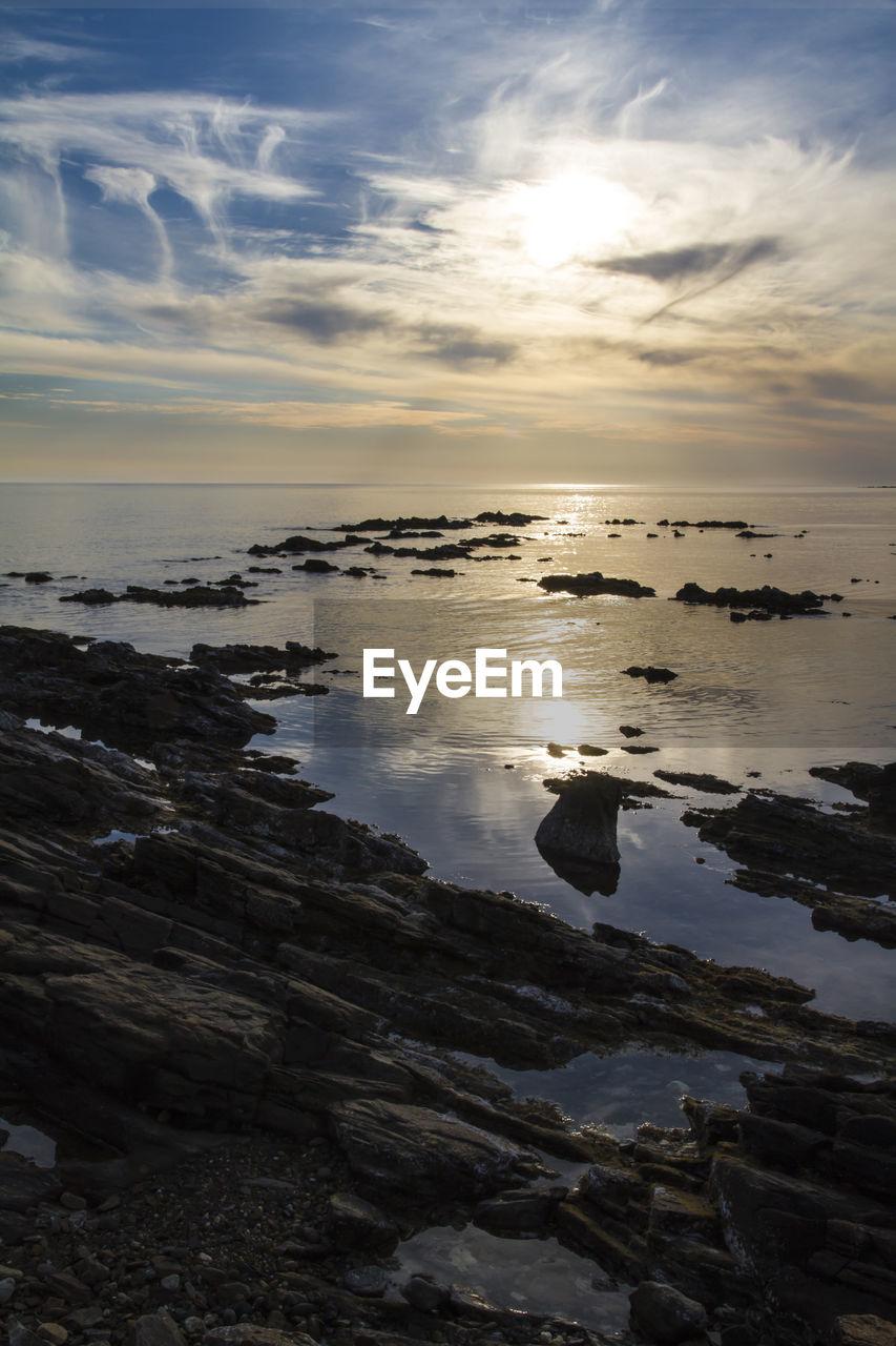 sky, water, cloud - sky, scenics - nature, beauty in nature, sea, sunset, tranquility, tranquil scene, reflection, land, horizon over water, beach, horizon, nature, idyllic, no people, rock, non-urban scene, sun, outdoors