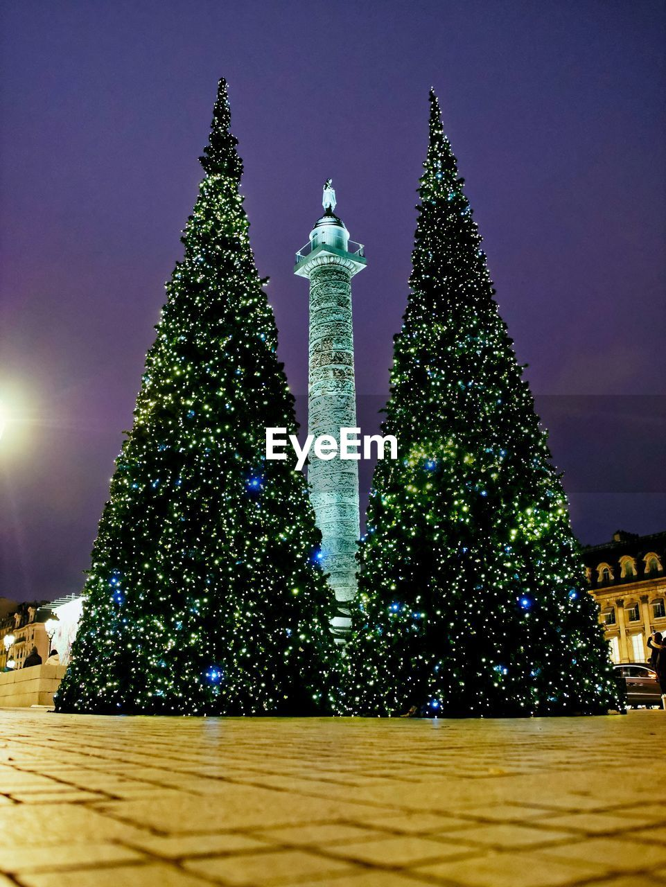 night, architecture, illuminated, low angle view, built structure, christmas tree, building exterior, tree, no people, outdoors, travel destinations, sky, nature