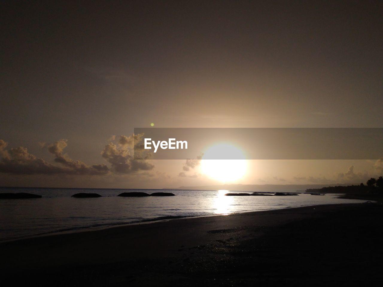 sky, water, sea, scenics - nature, sun, beauty in nature, sunset, tranquility, tranquil scene, beach, horizon over water, horizon, sunlight, nature, land, idyllic, silhouette, no people, outdoors