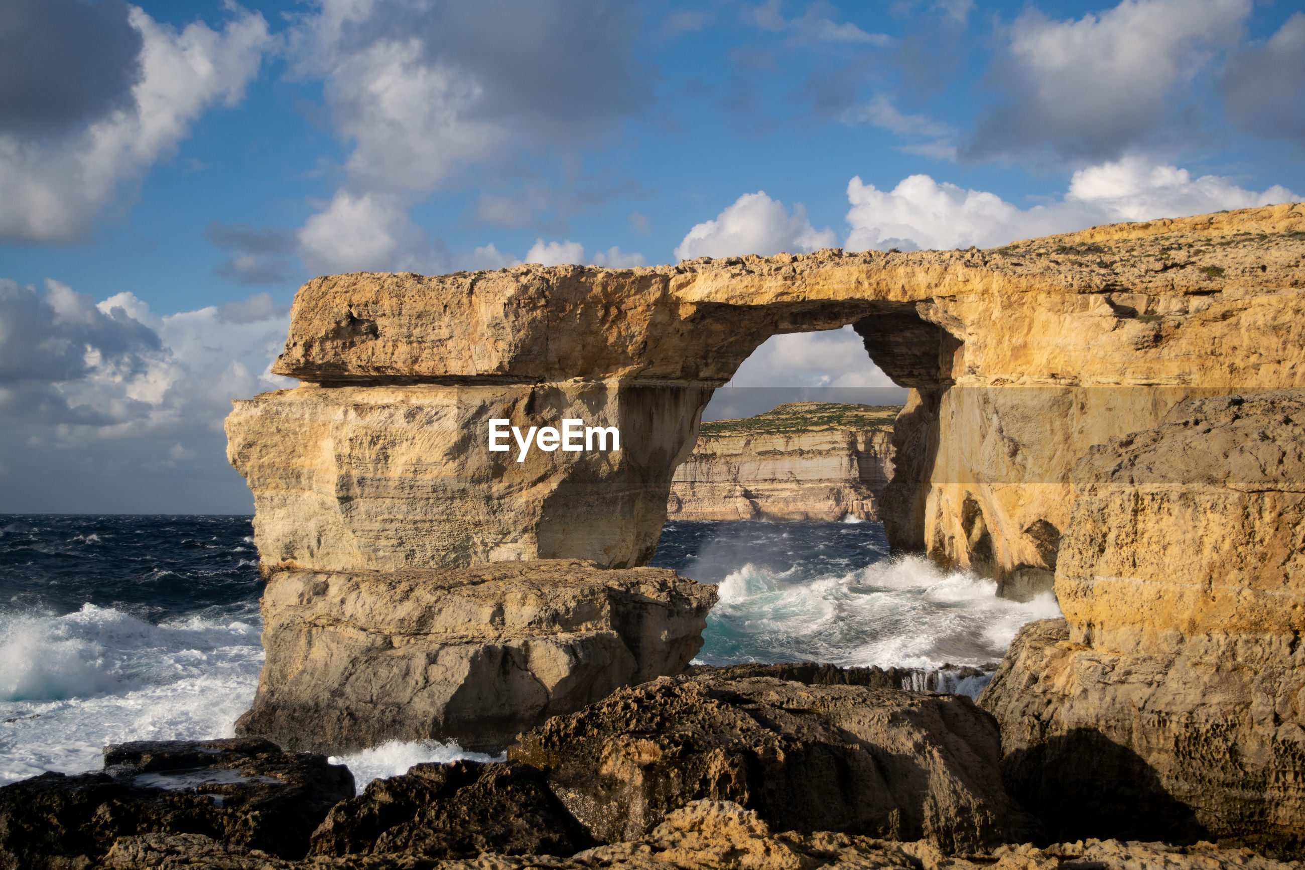 VIEW OF ROCK FORMATION ON BEACH