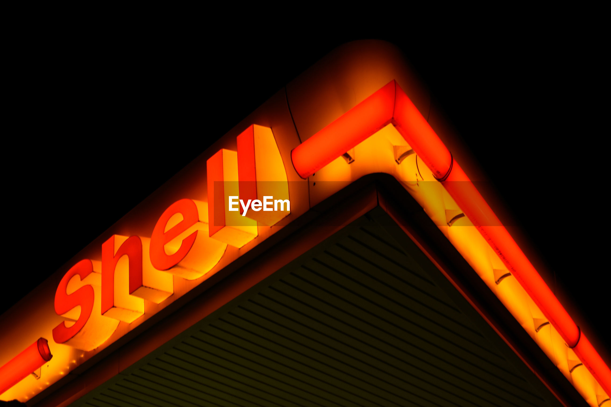 illuminated, text, communication, night, western script, sign, neon, no people, lighting equipment, glowing, orange color, low angle view, close-up, red, arts culture and entertainment, information, capital letter, information sign, indoors, architecture, black background