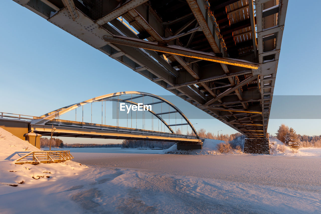 cold temperature, snow, built structure, bridge, architecture, winter, connection, bridge - man made structure, transportation, nature, no people, sky, day, road, metal, outdoors, covering, sunlight