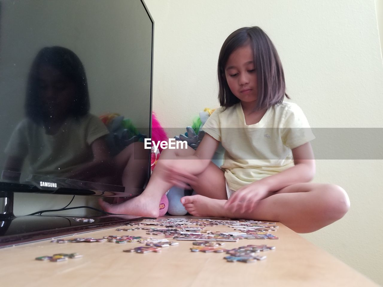 Girl Playing Jigsaw Puzzle At Home