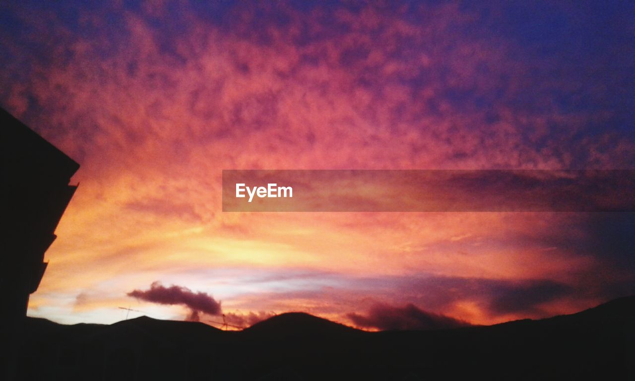 sky, sunset, cloud - sky, silhouette, beauty in nature, scenics - nature, orange color, tranquility, tranquil scene, mountain, nature, no people, idyllic, dramatic sky, outdoors, low angle view, majestic, environment, non-urban scene, dusk