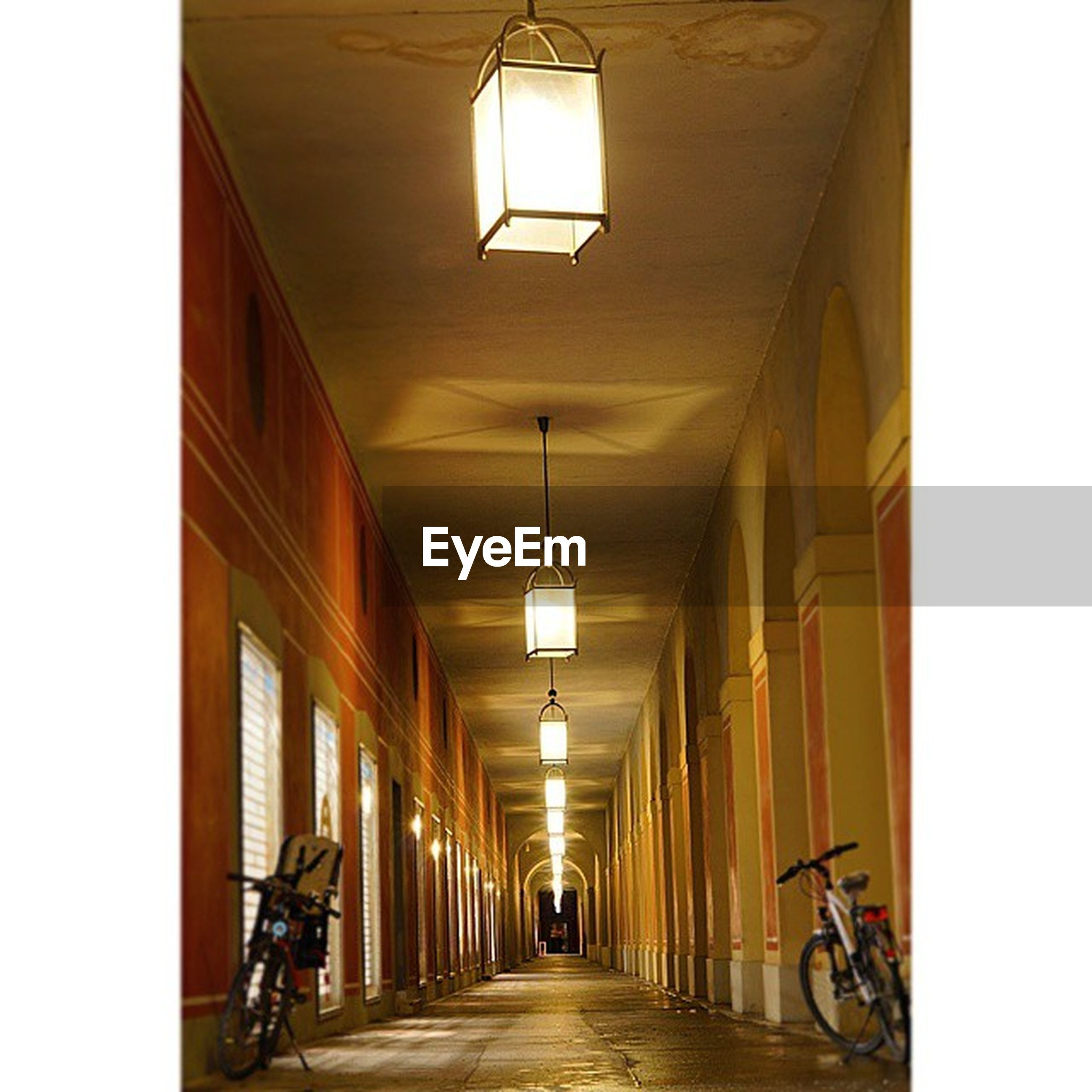 the way forward, architecture, built structure, indoors, transportation, bicycle, diminishing perspective, corridor, narrow, empty, vanishing point, ceiling, in a row, mode of transport, lighting equipment, absence, building, long, illuminated, wall