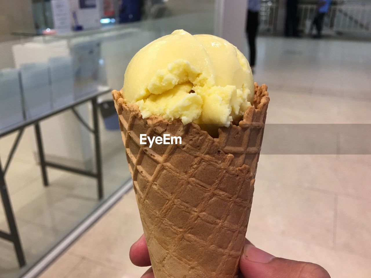 ice cream, sweet, frozen food, sweet food, frozen, dessert, dairy product, food and drink, food, human hand, indulgence, unhealthy eating, human body part, hand, temptation, freshness, unrecognizable person, holding, one person, ice cream cone, body part, finger, frozen sweet food, vanilla ice cream