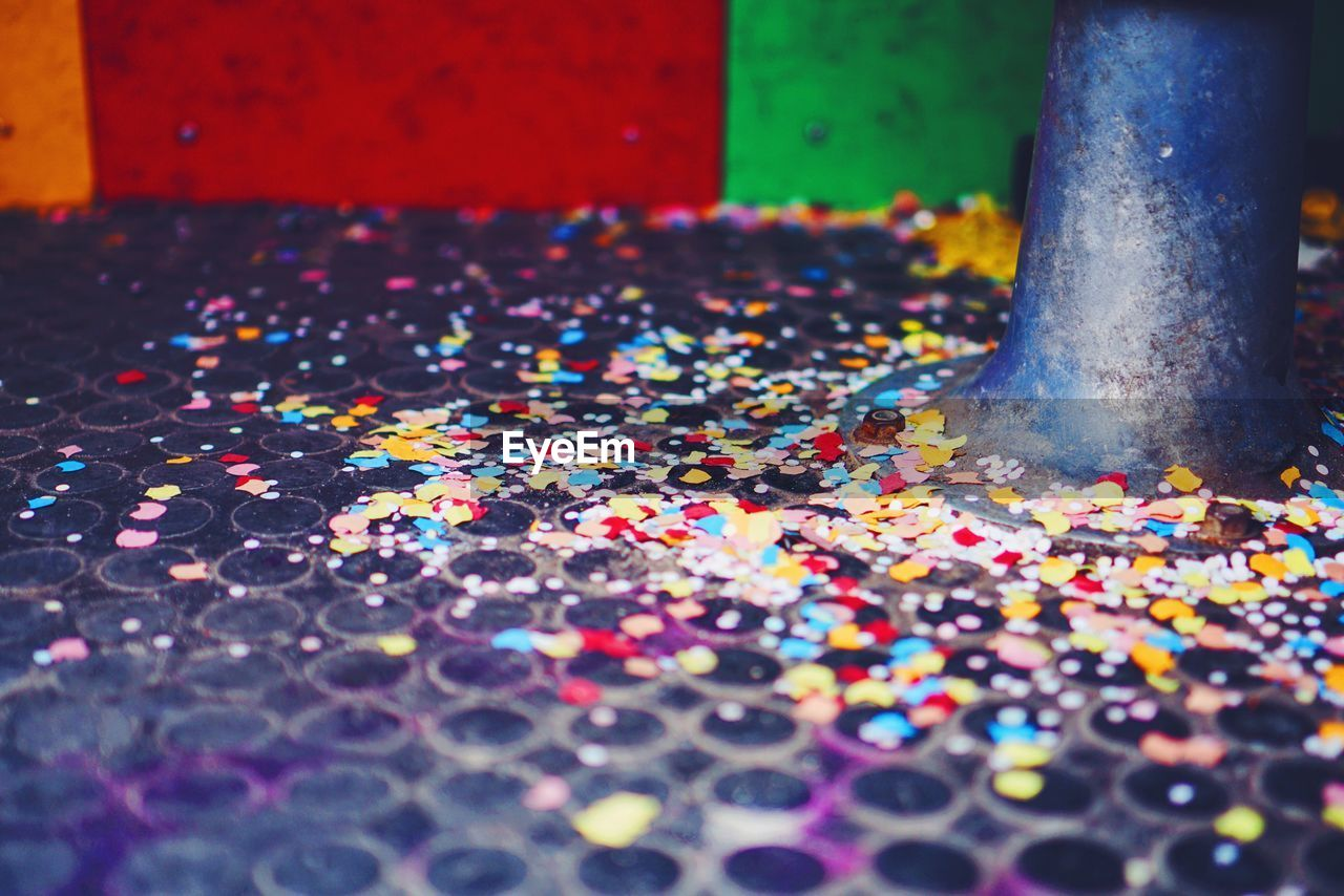multi colored, selective focus, celebration, confetti, day, no people, close-up, indoors