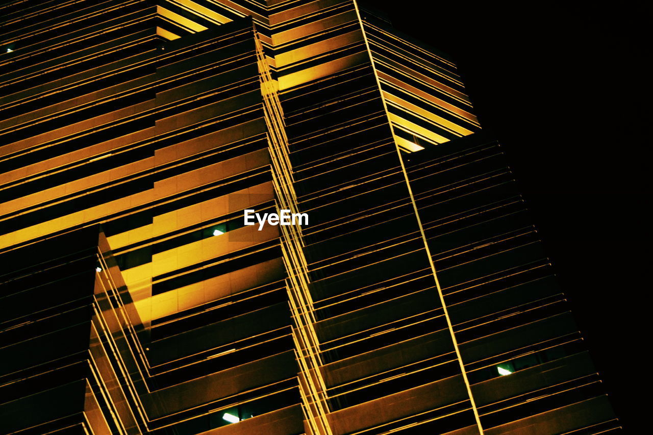 illuminated, low angle view, night, no people, architecture, built structure, building exterior, modern, outdoors, city, close-up