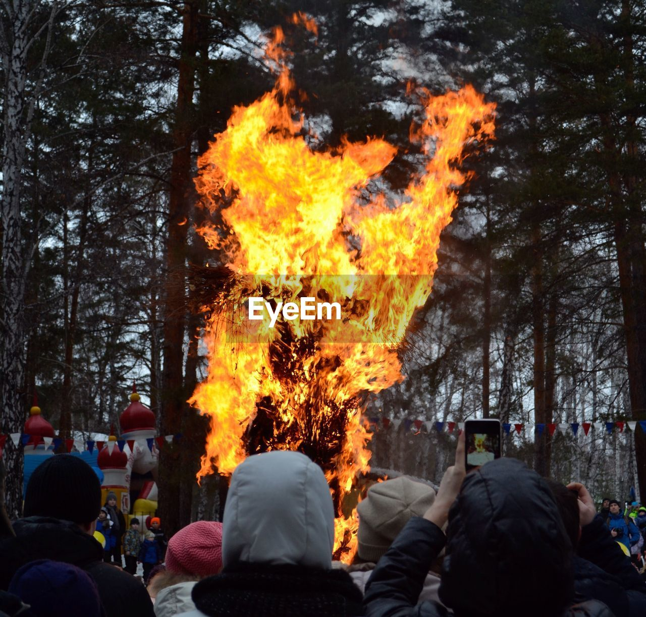 tree, real people, leisure activity, burning, men, flame, lifestyles, rear view, photographing, outdoors, women, one person, technology, day, photography themes, nature, sky, people, adult, adults only