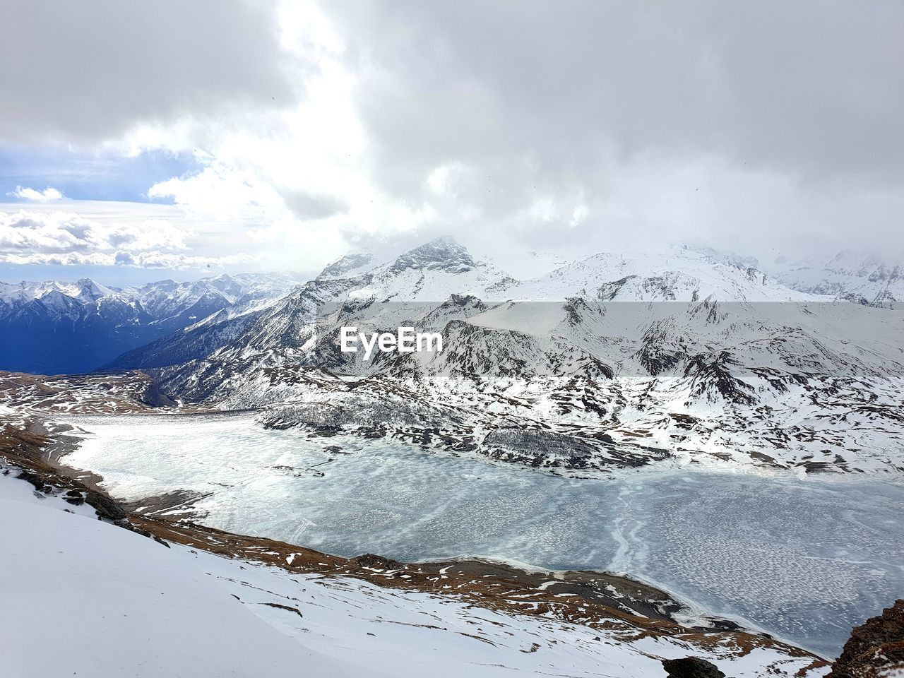 winter, cold temperature, beauty in nature, cloud - sky, scenics - nature, snow, mountain, sky, tranquility, tranquil scene, non-urban scene, nature, white color, day, snowcapped mountain, environment, mountain range, idyllic, no people, powder snow, range