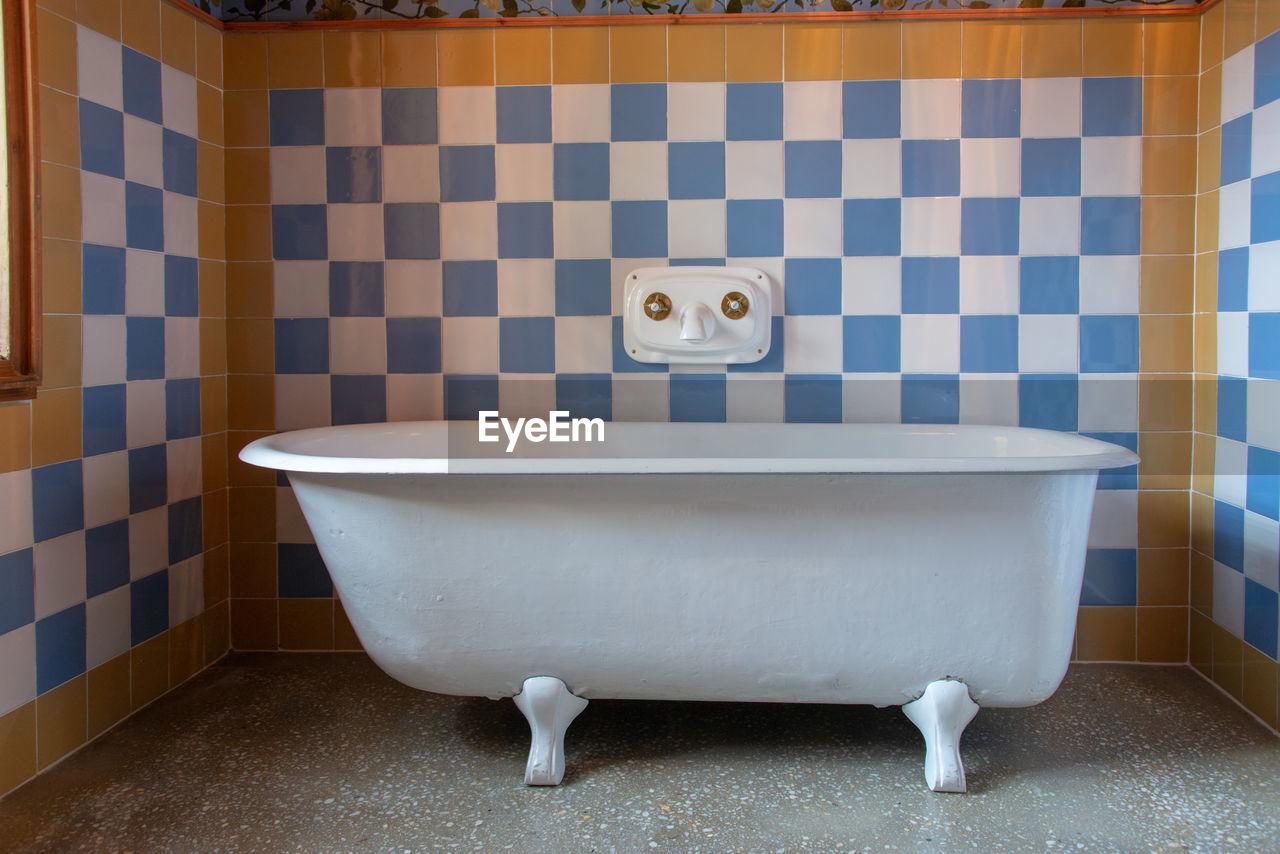 bathroom, domestic bathroom, flooring, toilet, domestic room, indoors, tile, hygiene, home, absence, sink, toilet bowl, no people, white color, wall - building feature, tiled floor, urinal, ceramics, bathtub, public restroom, clean