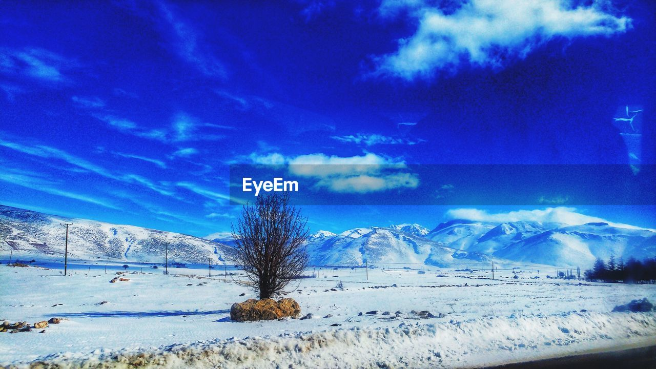 winter, snow, sky, cold temperature, beauty in nature, scenics - nature, cloud - sky, tranquil scene, tranquility, tree, landscape, plant, environment, non-urban scene, blue, land, mountain, nature, no people, snowcapped mountain, outdoors