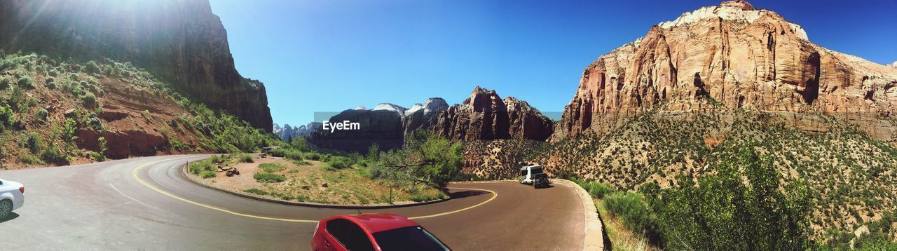 mountain, transportation, nature, sky, rock formation, road, day, scenics - nature, beauty in nature, plant, rock, sunlight, tranquility, tranquil scene, tree, no people, rock - object, mountain range, panoramic, travel, outdoors, formation