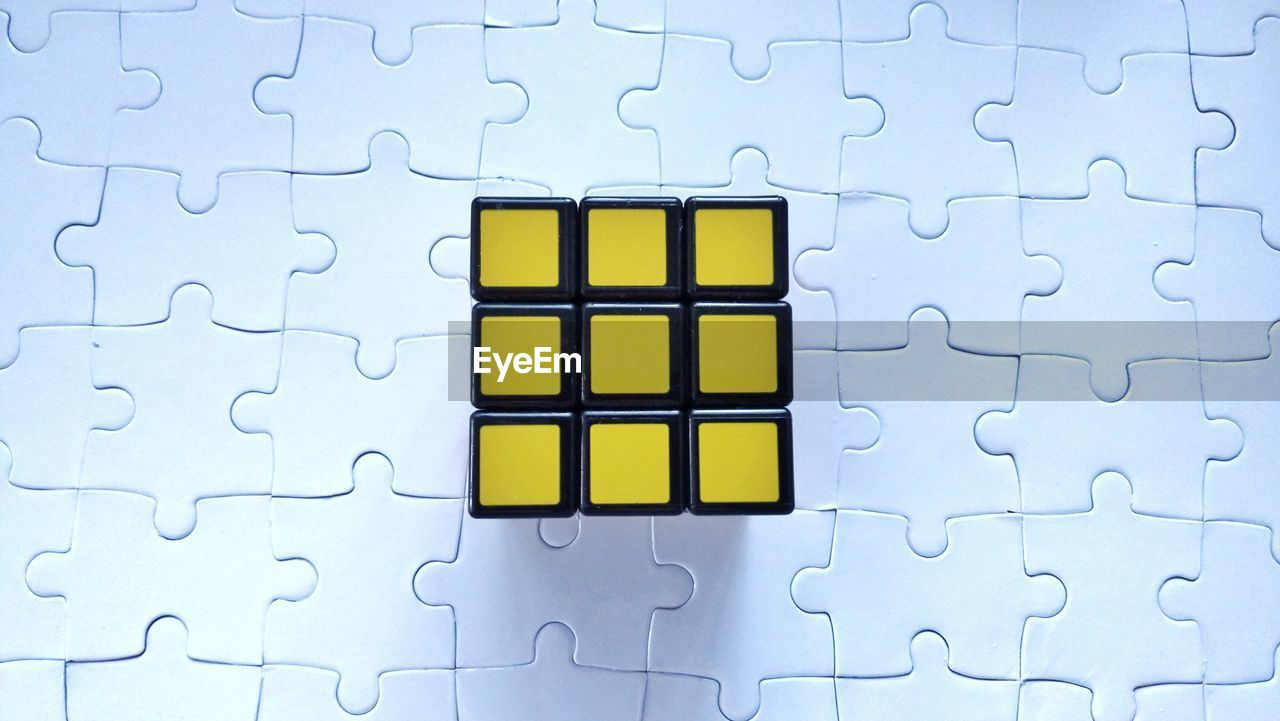 puzzle, pattern, jigsaw piece, indoors, no people, leisure games, jigsaw puzzle, connection, yellow, shape, relaxation, design, solution, full frame, close-up, incomplete, backgrounds, leisure activity, large group of objects