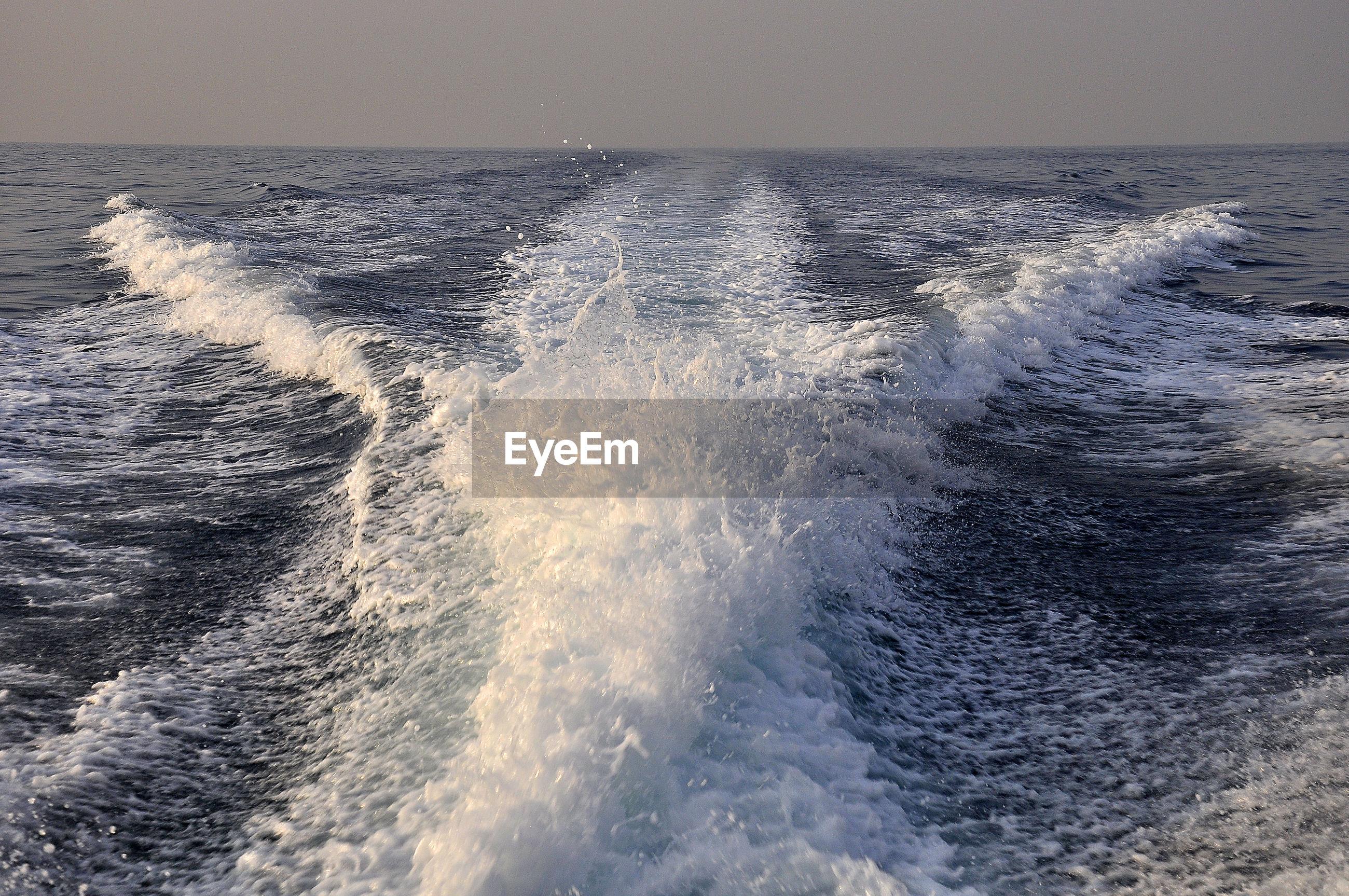 SEA AGAINST CLEAR SKY