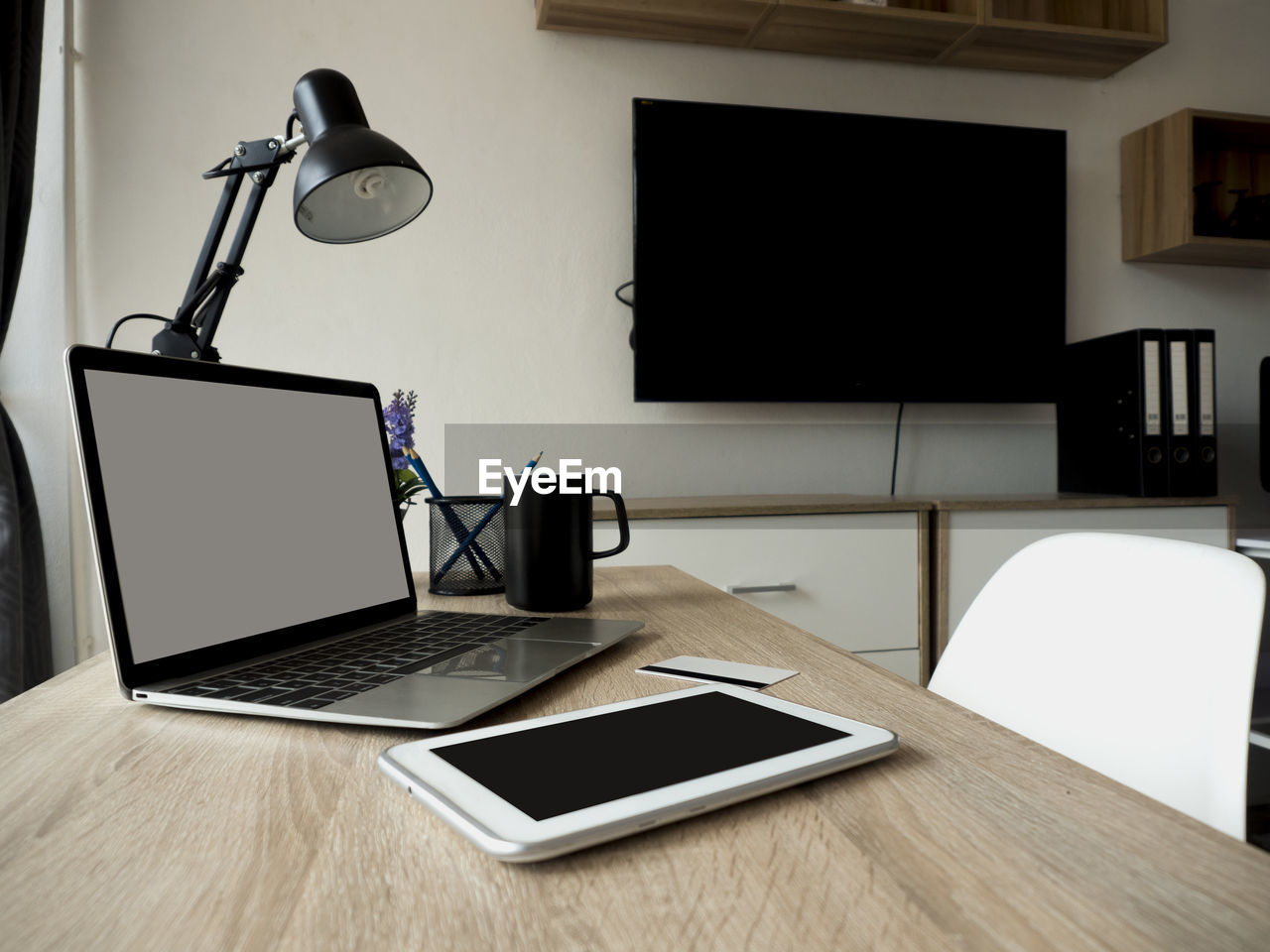 technology, wireless technology, connection, table, communication, computer, laptop, indoors, lighting equipment, no people, electric lamp, portable information device, absence, desk, furniture, cup, still life, smart phone, screen, business, blank