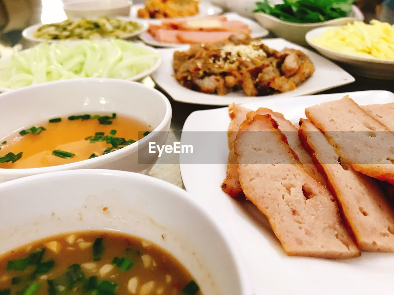 food and drink, food, ready-to-eat, freshness, plate, healthy eating, indoors, bowl, table, serving size, close-up, wellbeing, still life, no people, high angle view, vegetable, soup, indulgence, meat, focus on foreground, meal, temptation, crockery, serving dish