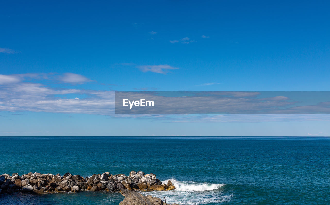 sea, water, sky, horizon over water, horizon, scenics - nature, beauty in nature, blue, rock, tranquil scene, cloud - sky, tranquility, solid, waterfront, rock - object, idyllic, nature, no people, day, rocky coastline, groyne
