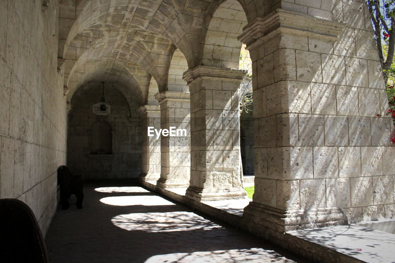 architecture, built structure, architectural column, arch, sunlight, indoors, building, day, arcade, the past, history, shadow, religion, corridor, place of worship, no people, nature, belief, spirituality, old, ancient civilization, colonnade