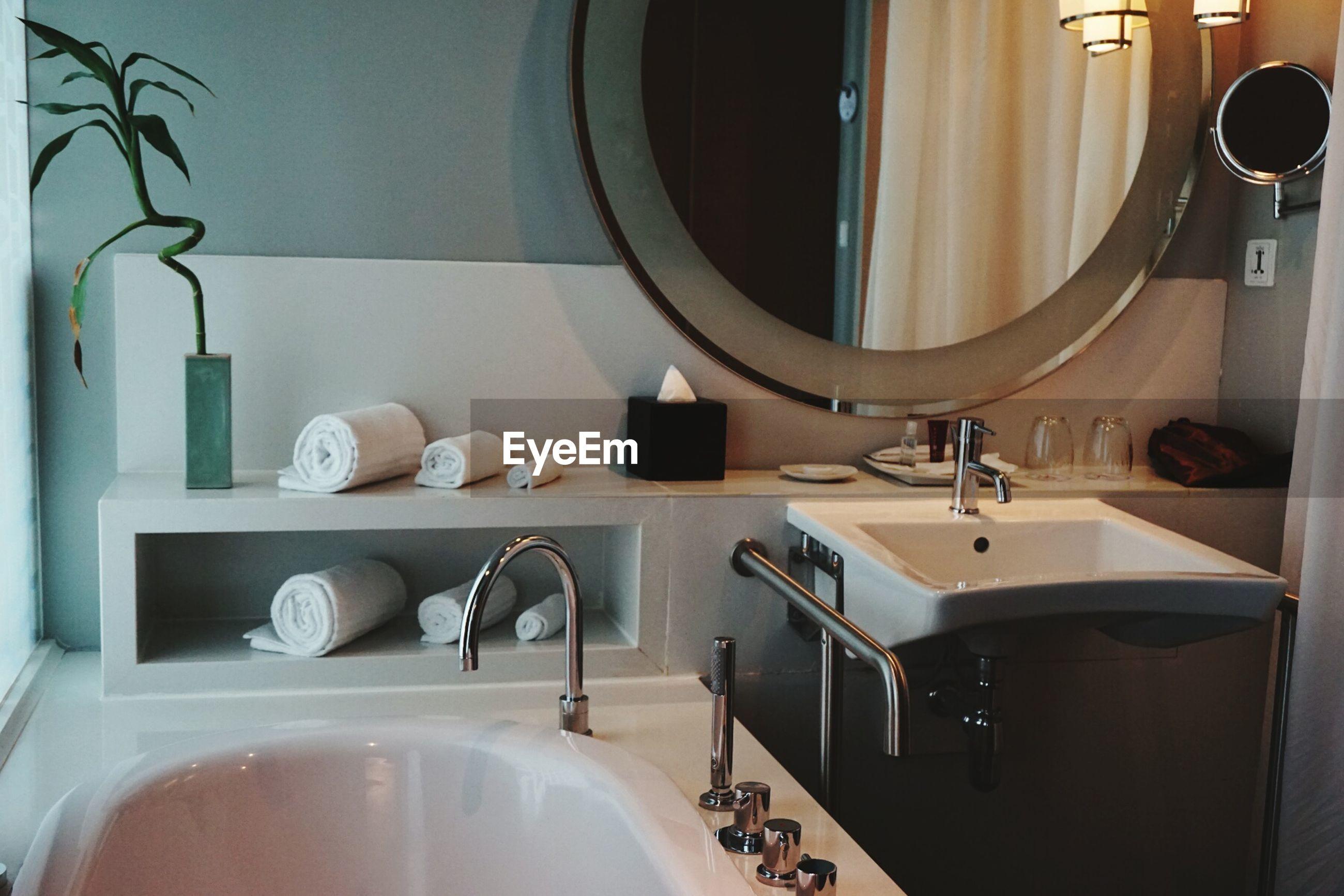 VIEW OF ILLUMINATED BATHROOM