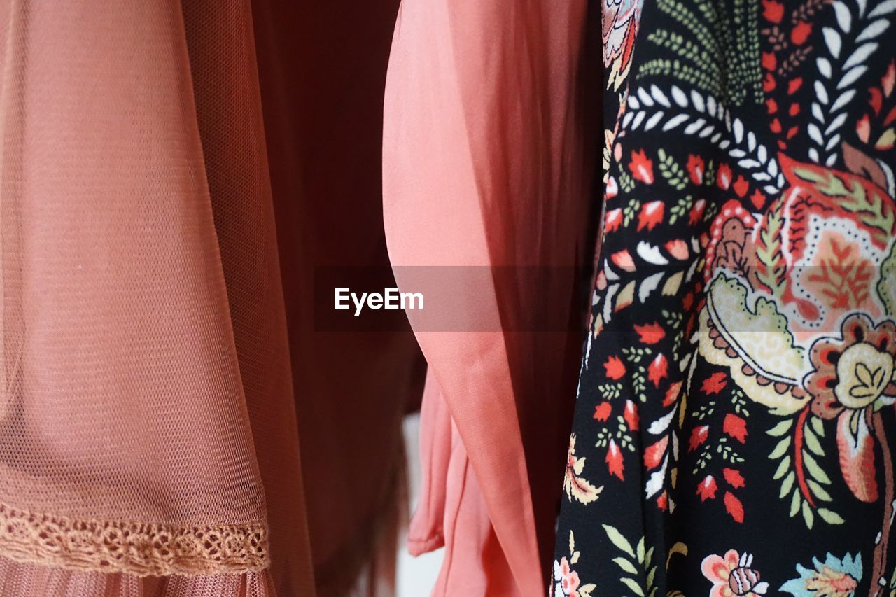 clothing, textile, pattern, fashion, no people, indoors, choice, retail, close-up, variation, hanging, dress, multi colored, for sale, design, floral pattern, store, clothing store, shopping, retail display, consumerism, womenswear, boutique