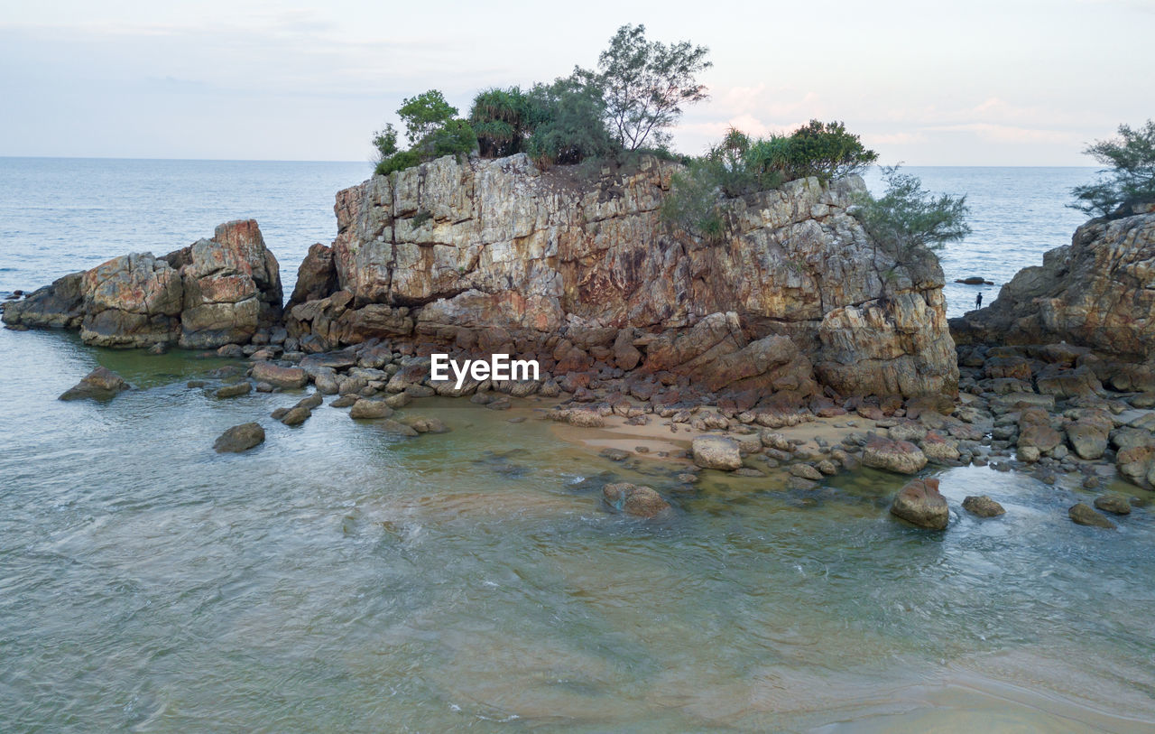 water, sea, sky, rock, solid, rock - object, nature, scenics - nature, horizon over water, land, tranquility, beauty in nature, tranquil scene, beach, horizon, rock formation, day, waterfront, no people, outdoors, rocky coastline