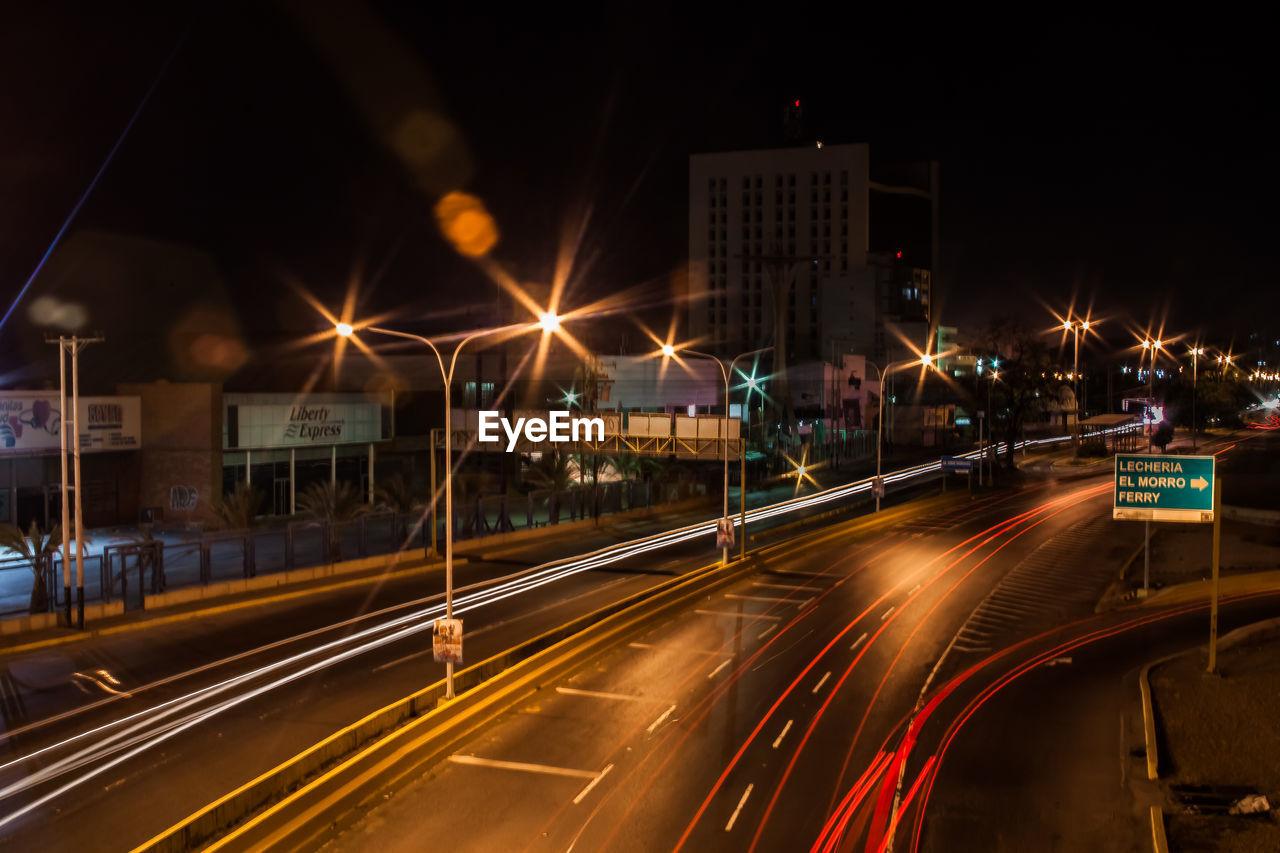 light trail, speed, illuminated, night, motion, long exposure, high street, transportation, blurred motion, traffic, road, street, street light, no people, city, urban scene, outdoors, architecture