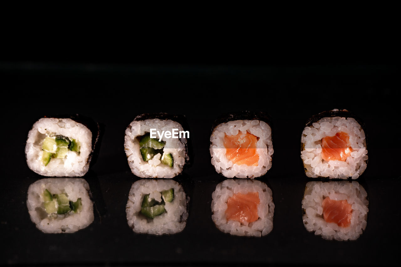 CLOSE-UP OF SUSHI AGAINST GRAY BACKGROUND