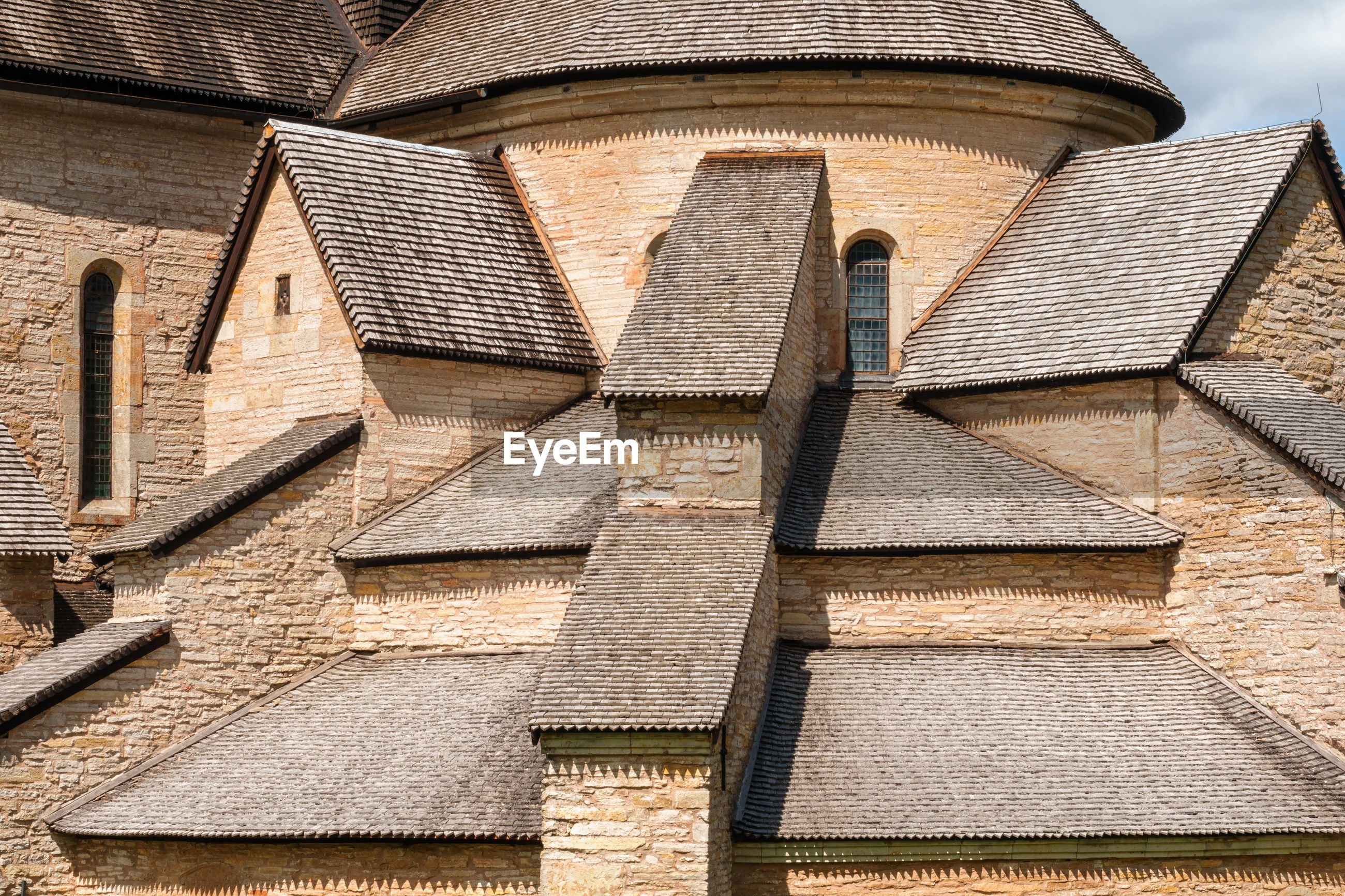 LOW ANGLE VIEW OF ROOF TILES ON BUILDING